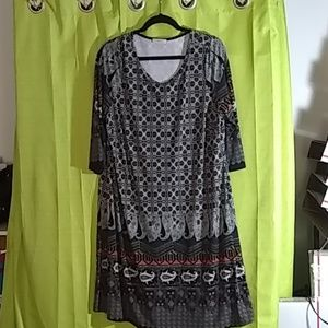 1X plus dress. Black with multi color accents